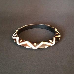 Brown, white plastic tribal bracelet